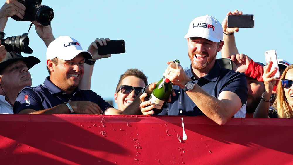Patrick Reed (left) and Jimmy Walker celebrate the historic win. (AAP)