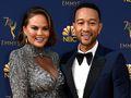 John Legend and Chrissy Teigen have not ruled out doing 'thankless' Oscars hosting job