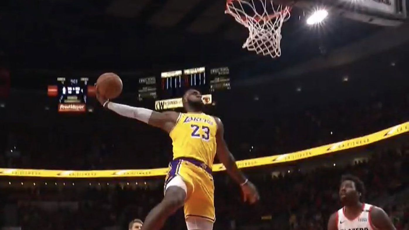 266bd0340 LeBron James starts life as a LA Laker with stunning double dunks