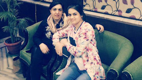Lima, pictured with her sister Rana Haydari in India, where Lima received a scholarship to study.