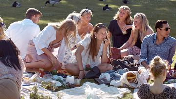 People picnic in June during the annual Midsummer celebrations in Stockholm, Sweden