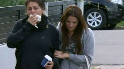 Mr Hijazi's mother was inconsolable when she heard of her son's death. (9NEWS)