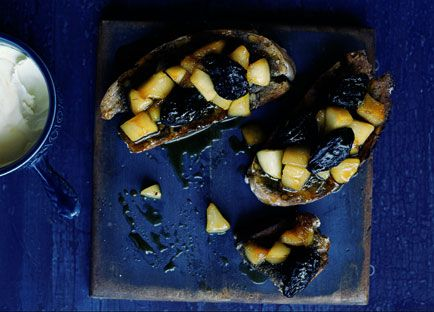 Baked pear and walnut tartines with frontignac, prunes and clotted cream