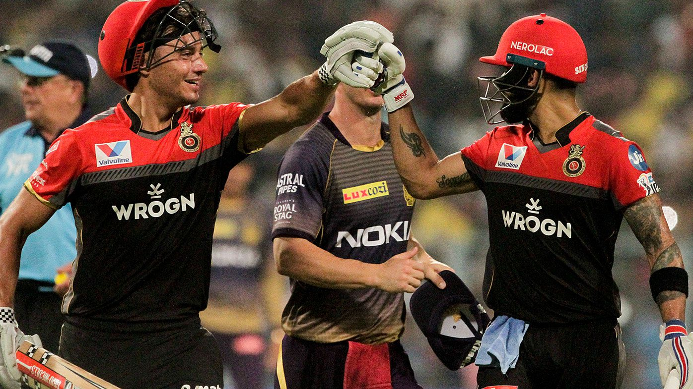 Royal Challengers Bangalore's Virat Kohli, right, and Marcus Stoinis encourage each other