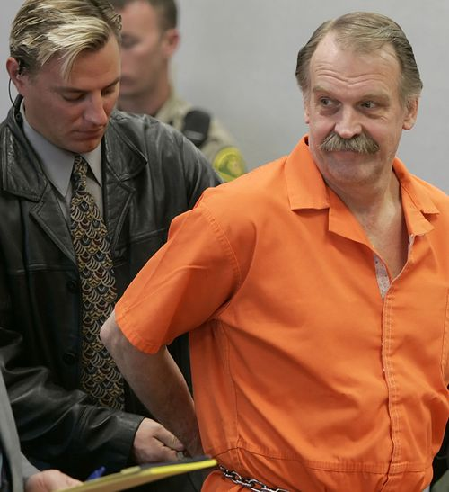 In this 2005 file photo, convicted murderer and death row inmate Ron Lafferty is handcuffed after his court hearing in a courtroom in Provo, Utah.