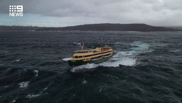 The Manly ferry battling high seas.
