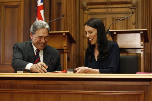 New Zealand First leader Winston Peters, left, and Prime Minister-designate Jacinda Ardern sign the coalition agreement last week. (AAP)