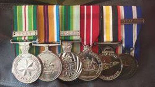 Jay Deeming's medals were returned today more nearly two months after being stolen. (9NEWS)