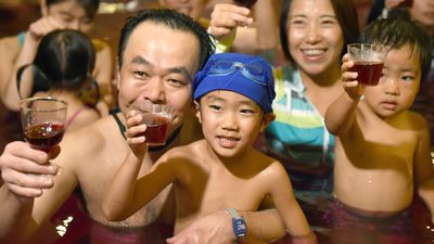 Parents and children celebrated in the 'wine bath' party. (AAP)