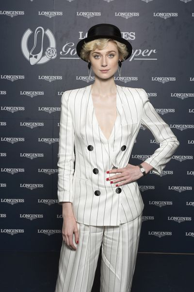 <p>Prestigious Swiss watchmaker, Longines, entered the autumn racing carnival in style over the weekend, hosting a luncheon in the Grand Pavilion at Rosehill Gardens Racecourse. </p> <p>Actress Elizabeth Debicki from The Man From Uncle, who is the brand&rsquo;s Golden Slipper ambassador, played hostess to a bevy of high profile guests who were attending in celebration of the lucrative race. </p> <p> Among the line-up of guests were radio host Emma Freedman, media identities Laura Dundovic and Nikki Philips , I&rsquo;m a Celebrity &hellip; Get me out of here! contestant Tegan Martin and racing personality Tom Waterhouse, all shining on the red carpet. Showing off an array of ensembles, from striking red dresses, eye-catching hats and pinstripe pant suits, they definitely set the tone in the style stakes for autumn racing.</p> <p>Longines Golden Slipper ambassador, Elizabeth Debicki.</p>