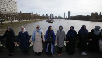 Dozens of women held hands on Westminster Bridge to remember victims of the London terror attack. (AFP)