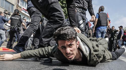 Police detain a demonstrator during May Day protests in Istanbul, Turkey. (AP).