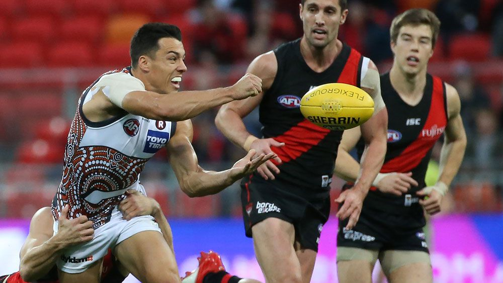 Giants topple Bombers to go top of AFL