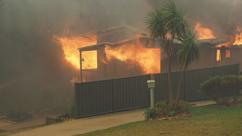 A home well and truly alight in Tathra. Picture: Supplied