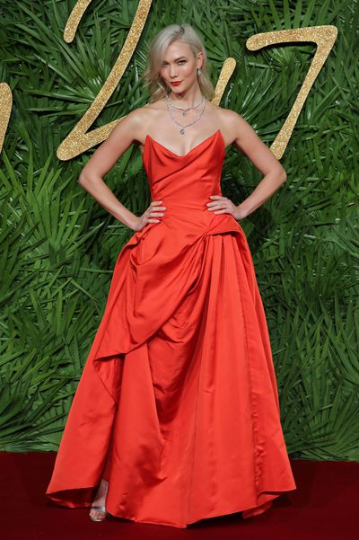 """American supermodel <a href=""""https://style.nine.com.au/karlie-kloss"""" target=""""_blank"""" draggable=""""false"""">Karlie Kloss</a> wore her style credentials on her sleeve as co-host of the <a href=""""https://style.nine.com.au/2017/12/05/08/29/british-fashion-awards-2018"""" target=""""_blank"""" draggable=""""false"""">British Fashion Awards 2017</a>, changing outfits seven times.<br /> Working beside comedian Jack Whitehall, the US Vogue favourite swapped effortlessly from Vivienne Westwood (pictured) to Gucci, to Erdem and even squeezed in a vintage Versace number to honour icon honouree Donatella Versace.<br /> Helping pull the distinct looks together for the 25-year-old was her star stylist Karla Welch, who also works with Ruth Negga, Lorde, Kaia Gerber and Amber Heard.<br /> Welch&rsquo;s favourite look from the night was a fitted blue dress with red gloves from Designer of the Year winner Raf Simons for Calvin Klein.<br /> The hosting gig capped off a stellar year for Kloss who is ranked the seventh-heighest earning model in the world and has 12.6 million social media followers. As well as championing her Kode initiative to get girls into computer coding, Kloss has worked with Swarovski and returned to the runway for Victoria&rsquo;s Secret in Shanghai.<br />"""