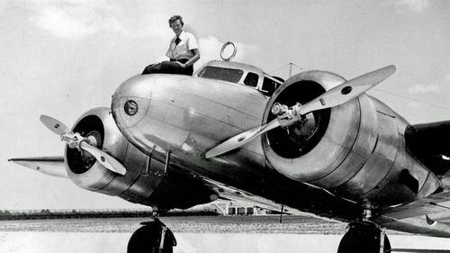 Amelia Earhart before takeoff in Miami for an attempted round-the-world flight. Earhart and her navigator, Fred Noonan, disappeared in the South Pacific in July 1937, while on one of the last legs of that journey. (AP).