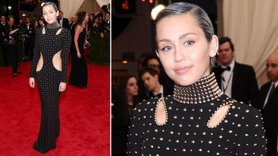 She's just being Miley in a Alexander Wang gown and slicked-back blue and green hair. (AAP)