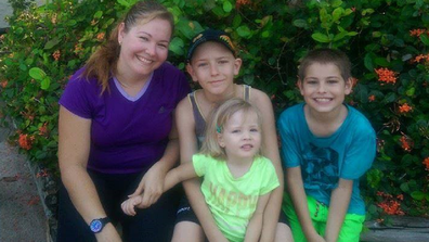 Leah with her children sitting down