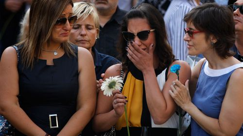 Clutching flowers, many broke down in tears as they stepped onto Las Ramblas.