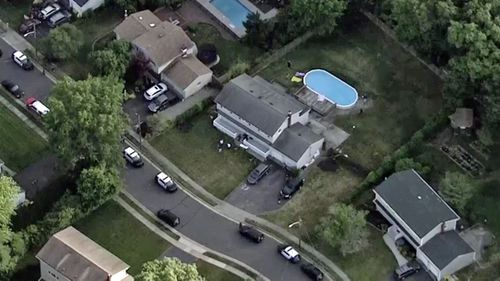 An aerial photo of the house and pool where the bodies were found.