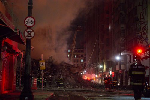 The building collapsed after it had burned for hours. (AP/AAP)
