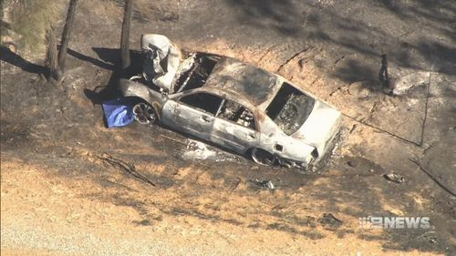 A bushfire was sparked when the car burst into flames. (9NEWS)