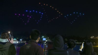 One hundred drones are lit up as a stylized Opera House during a display over Sydney Harbour on Wednesday. (AAP)