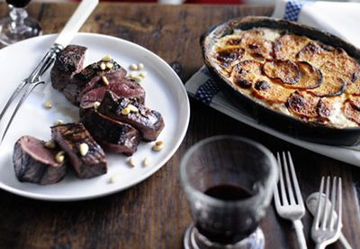 Roast venison potato gratin infused with pine nuts