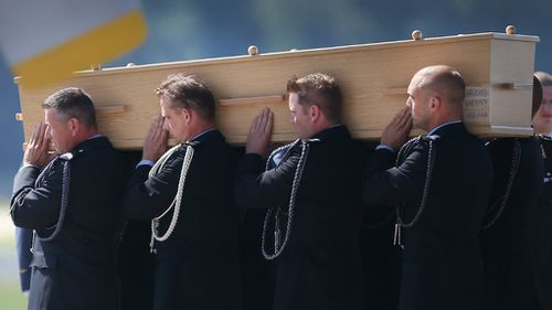 Each coffin, containing unidentified remains from the crash, has been numbered. (Getty Images)
