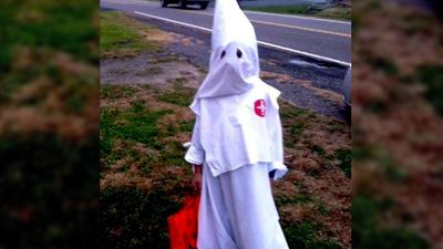 <b>Klu Klux Klan:</b> With the reputation of the Klan, it is best to avoid dressing your child up in a tiny Klu Klux Klan outfit. (Picture: WHSV-TV)