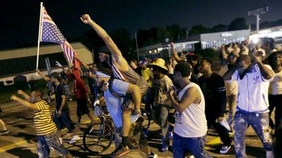 Protesters march down a street in Ferguson on Monday night. (AP)