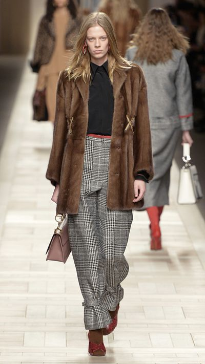 Fendi goes for a more refined look here, pairing fur with a classic checked print pant.