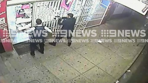 With guns drawn, police arrived and arrested the men. (9NEWS)