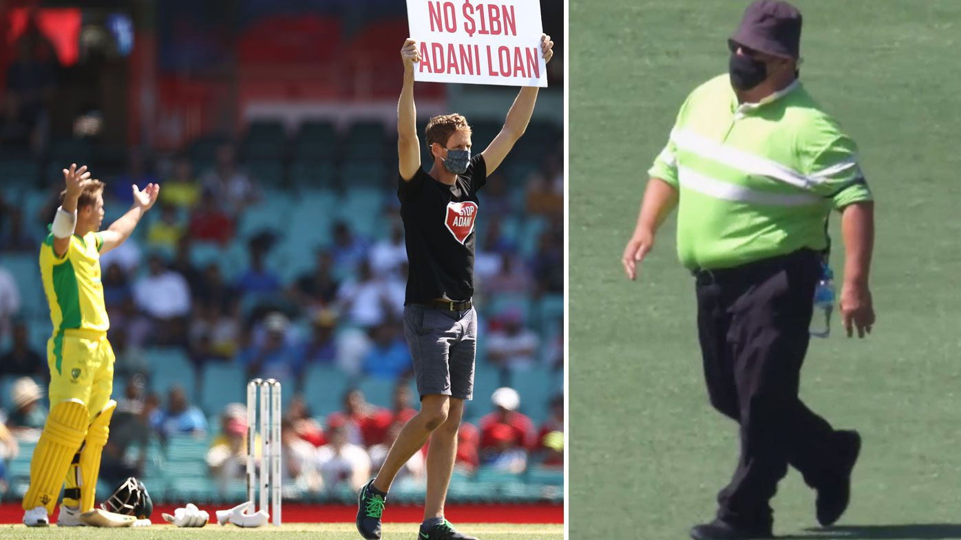 It was a bizarre moment early in the first ODI when pitch invaders were left to wander around the wicket for some time until security arrived. (Getty/Twitter).