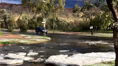 <p>Hail melts on an Alice Springs road.</p> <p>(Higgins Storm Chasing)</p>