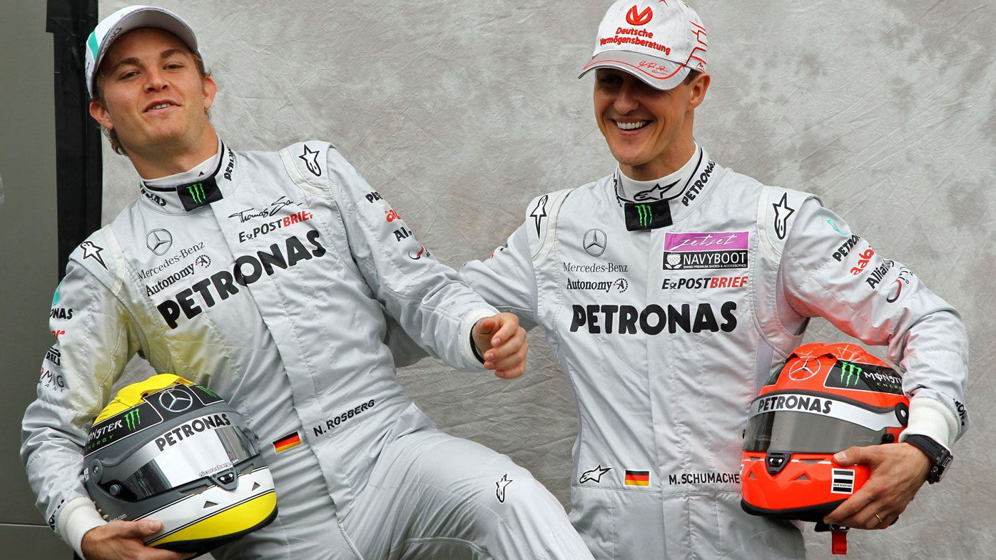 German Formula One driver Michael Schumacher (R) and his teammate Nico Rosberg of Mercedes