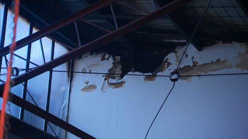 Damage from inside an adjacent building.
