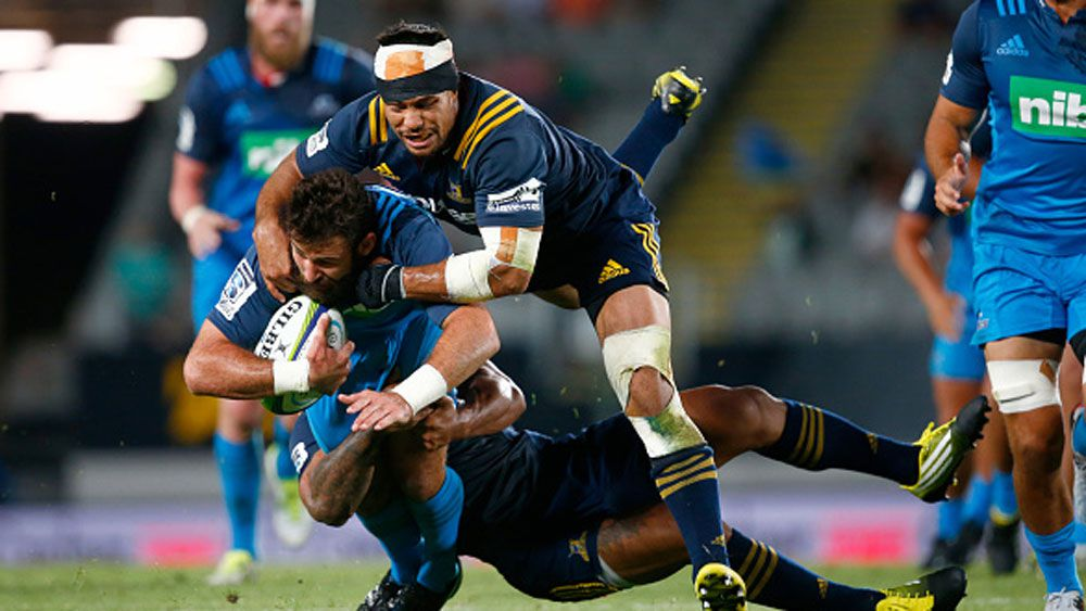 Billy Guyton of the Blues is tackled during their win over the Highlanders. (Getty)