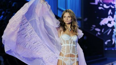 Polish model Magdalena Frackowiak shows white is right during the Victoria's Secret Fashion Show in London. (AAP)