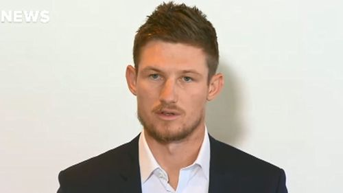 A dismayed Cameron Bancroft faces the press after flying into Perth from South Africa. Picture: 9News