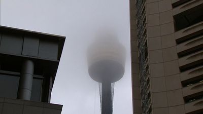 Sydney's Centrepoint tower hides behind the rain clouds. (9NEWS)