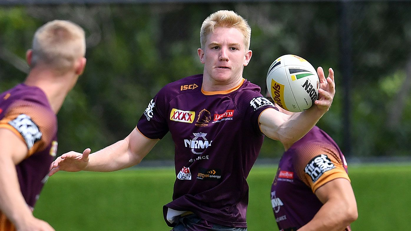Tom Dearden (centre) in action during Brisbane Broncos training