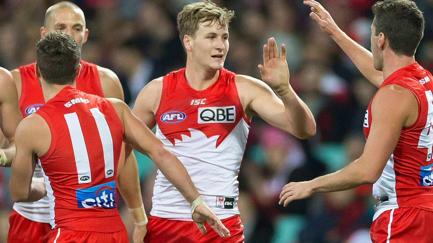 Young Swans stand tall to end losing streak against 'disgraceful' Essendon Bombers