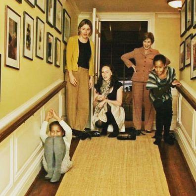 Malia and Sasha Obama slide down the White House banisters as Jenna, Barbara and Laura Bush look on.