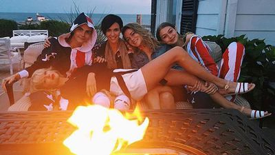Rose share this photo of the group huddled up beside a fire. (Instagram: @rubyrose)