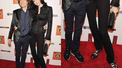 Mick Jagger's super tall girlfriend crouches to match his height on the red carpet