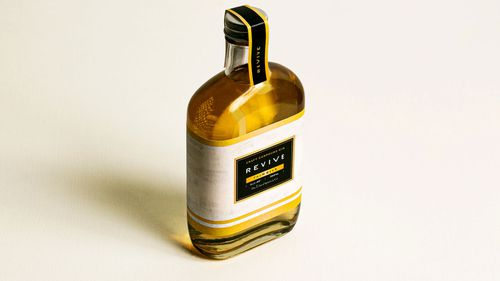 Revive gin is made with Budweiser beer, and flavored with lemon peel, beech wood, cinnamon and san'ontō, a dark, sweet sugar.