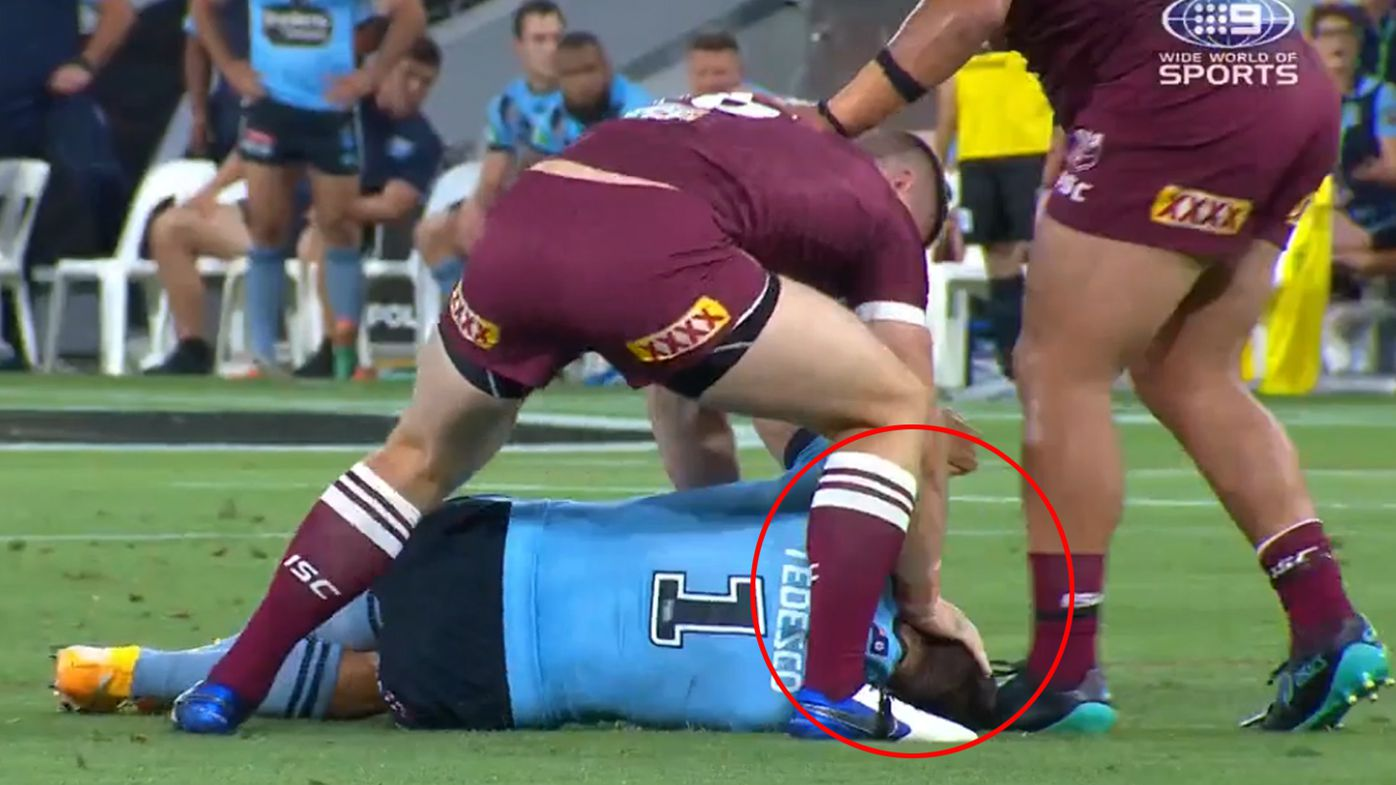Jai Arrow pushes James Tedesco's head into the turf