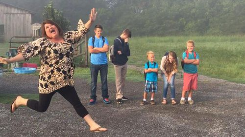 Mum jumps for joy in back-to-school photos