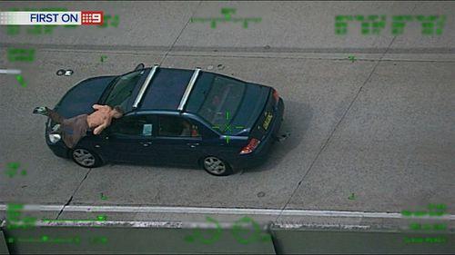 The driver mows him down. (9NEWS)